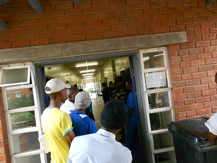 Line of men waiting to be circumcised in Lesotho