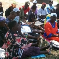 Community Health Workers reviewing their performance. (Photo courtesy of MCHIP.)