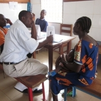 Vaccinator sharing FP information during a child's immunization visit. (Photo courtesy of Chelsea Cooper.)
