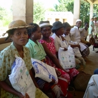 Women in Madagascar receiving bed nets. (Photo courtesy of Jhpiego.)