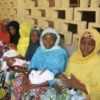 Women waiting for newborn care at a nursery.
