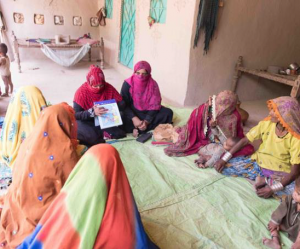 Shagufta Razzaque holds a community support group meeting in Yousfani Farm