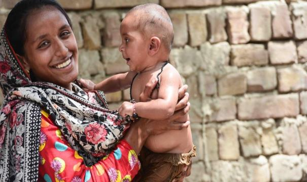 Kausar holds her healthy 7-month-old daughter.